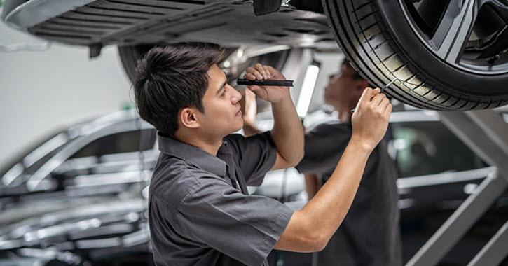 MINI Mechnaic Checking Tire Wear